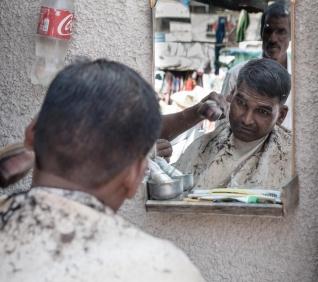 cutting the hair, Udaipur, India.