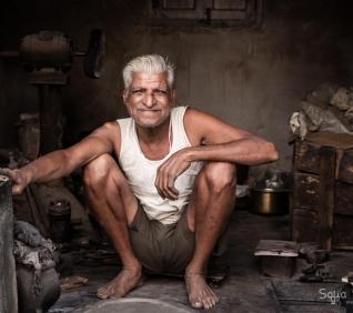 Man, Udaipur shop, India.