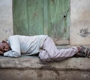 Man sleeping, Delwara, India.
