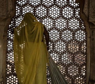 Woman, window, Jaipur, India.
