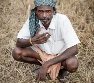 Men smoking, countryside, Kumarakon.