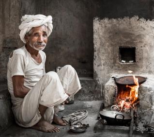 Men, cooking, Narlai, India