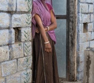 Woman at the door, Narlai, India.