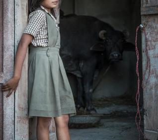 Girl at the door, Narlai, India.